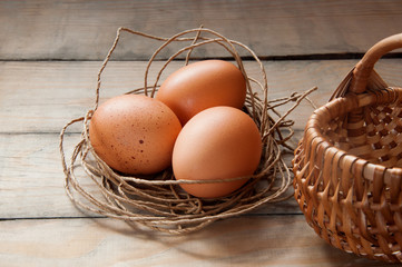 three eggs in a nest of thread