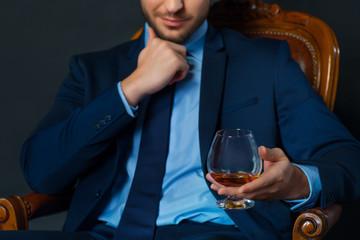 Handsome businessman drinking alcohol