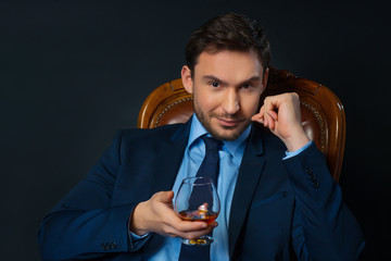 Intelligent man drinking cognac