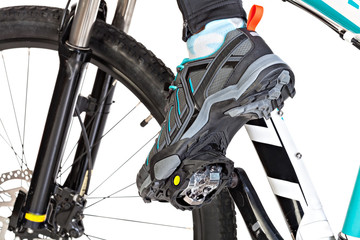 View from below of special contact shoe attached to the bicycle
