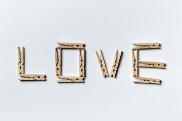 Сlothespins sign love word