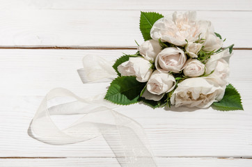 bunch of white roses on white table.top view