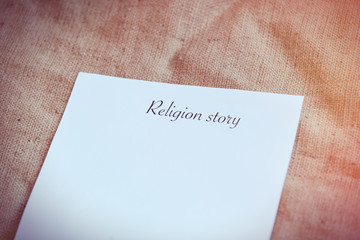 Paper with words Religion story