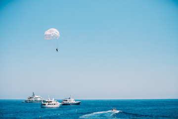 Parasailing in open sea. Water sports