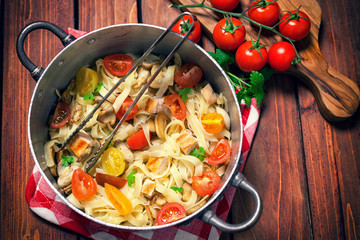 Homemade pasta with mushroom,chicken meat and vegetables