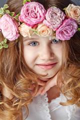 Beautiful little girl with bunch, studio