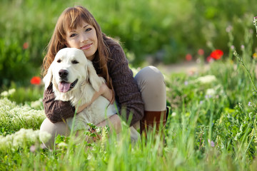 Woman with dog on nature