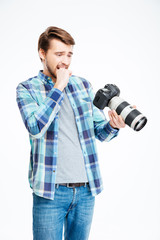 Stressed male photographer holding photo camera