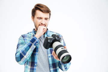 Upset male photographer holding photo camera