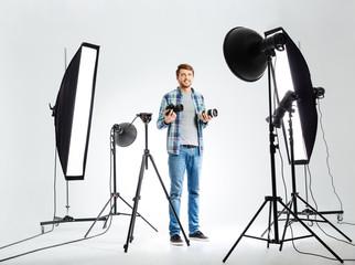 Photographer standing in studio with equipments