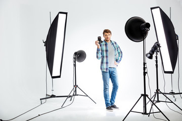 Photographer standing with photo camera