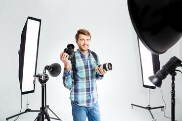 Photographer standing in photo studio with equipments