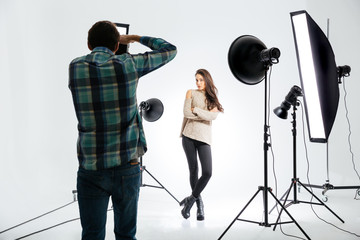 Photographer working with female model