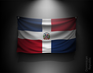 waving flag Dominican Republic on a dark wall