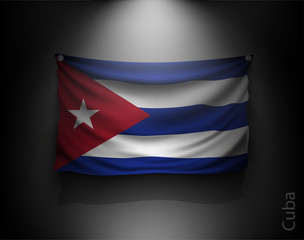 waving flag cuba on a dark wall