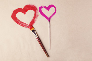 Two hearts painted with brushes on Valentine's day celebration