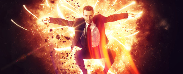 Wide view of leaping businessman in explosion