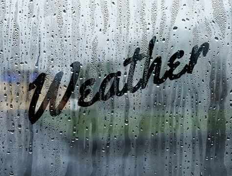 Weather written on a foggy window