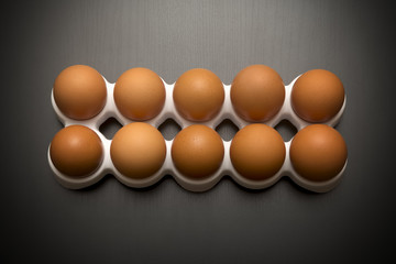 Group Of Brown Chicken Eggs On A Dark Surface