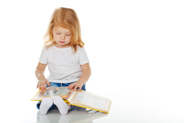 Little girl are reading a book
