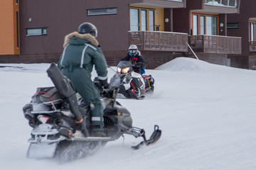 People on a snowmobiles  in Longyearbyen, Spitsbergen (Svalbard)