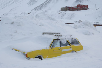 Car covered with snow. Longyearbyen, Spitsbergen (Svalbard). Norway