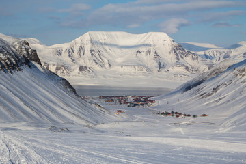 The city is surrounded by mountains. Longyearbyen, Spitsbergen
