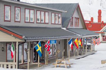 The flags on one of the buildings in Longyearbyen, Spitsbergen