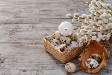 Easter bunny on basket full of quail eggs