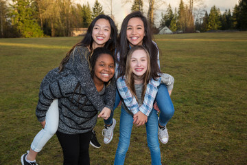 Group of happy kids playing outside