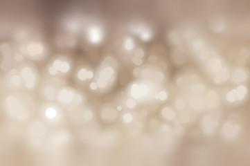 Bokeh light, shimmering blur spot lights on beige abstract
