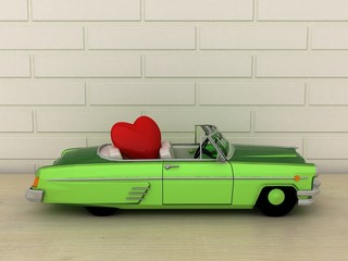 Old vintage miniature green cabriolet, convertible car carrying a red heart. Love and valentine concept.