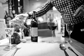 black and white photo restaurant serving