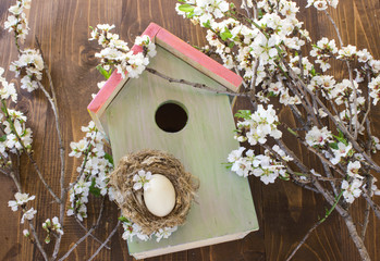 birdhouse and flowering branch.