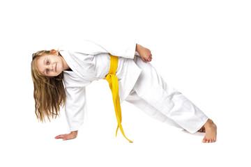 Studio shot of an adorable girl in kimono training martial art