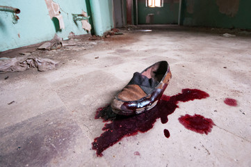 dirty old shoe with blood