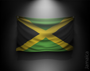 waving flag jamaica on a dark wall