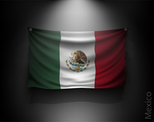 waving flag mexico on a dark wall