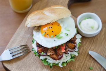 Shot of burger with fried egg top view