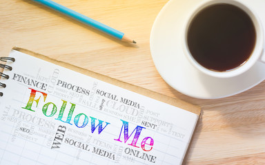 Concept Follow Me message on book. A pencil and a glass coffee table.Vintage tone.