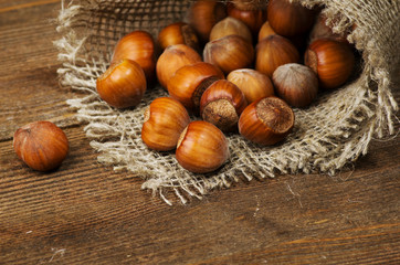 pile of nuts in shell on wooden table