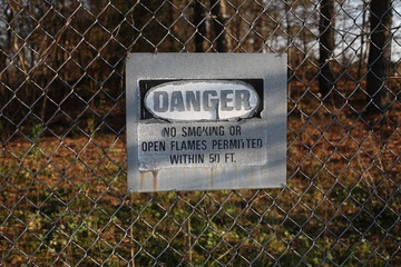 Danger no Smoking or Open Flames Permitted Within 50 Feet Sign on Fence