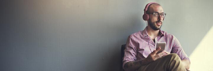 Man Sitting Technology Lifestyle Listening Concept