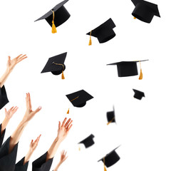 Graduates hands throwing graduation hats , isolated on white
