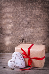 Festive gift box  and decorative red  heart
