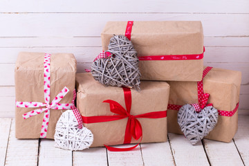 Festive gift boxes and  grey and whute decorative hearts  on whi