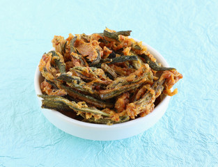 Indian vegetarian snack made from deep-frying okra cut into vertical pieces.