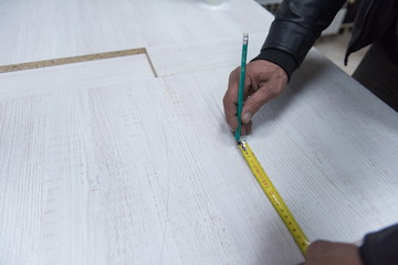 carpenter worker measuring