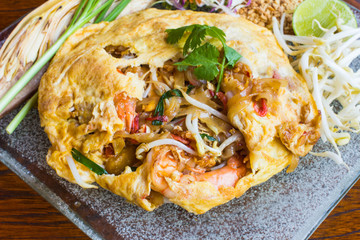 Fried noodle wrapped with eggs, Thai style food , Pad thai