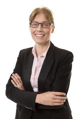 Close up shot of a smart office worker in a suit jacket, wearing glasses with her arms folded,  isolated on white.